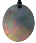 Teslas Adult Patterned Oval Pendant - The pendant has the effect of strengthening the wearers energy field, thus helping to alleviate the bio-energy effects of some man-made EMF/EMR. Oval Pendant - The pendant has the effect of strengthening the wearers energy field, thus helping to alleviate the bio-energy effects of some man-made EMF/EMR.